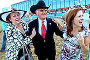 Archarcharch trainer William Jinks Fires is congratulated by Beverly Duncan, left, and daughter Krystal Court after winning the Arkansas Derby at Oaklawn Park on Saturday. xixix, derby