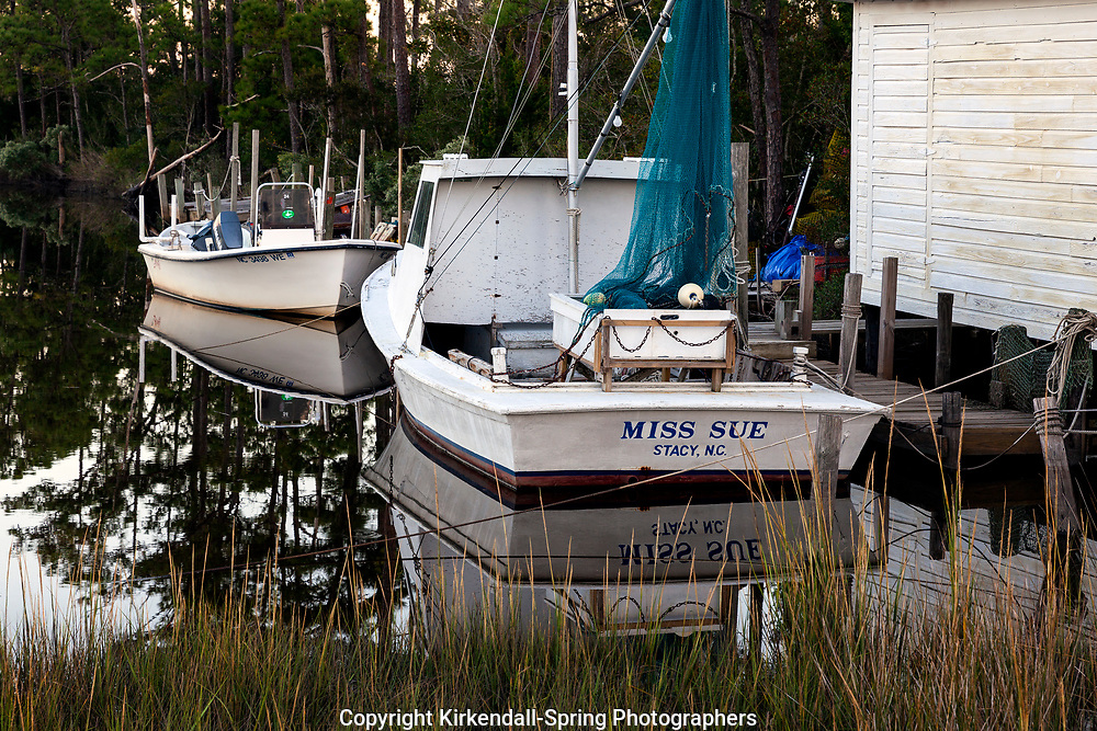 NC00851-00...NORTH CAROLINA - Boats docked along a slough near the town of Stacy.