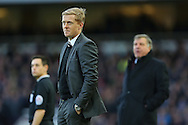 Manager of Swansea City, Garry Monk (left) and Manager of West Ham United, Sam Allardyce (right) during the Barclays Premier League match at the Boleyn Ground, London<br /> Picture by Richard Calver/Focus Images Ltd +447792 981244<br /> 07/12/2014
