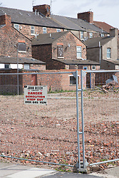 Fenced off area where houses have been demolition for the pathfinder regeneration scheme Bootle; Liverpool; England,