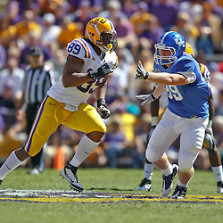 October 1, 2011; Baton Rouge, LA, USA;  LSU Tigers defensive end Lavar Edwards (89) rushes past Kentucky Wildcats tight end Tyler Robinson (89) during the fourth quarter at Tiger Stadium. LSU defeated Kentucky 35-7. Mandatory Credit: Derick E. Hingle-US PRESSWIRE / © Derick E. Hingle 2011