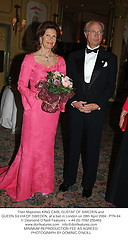 Their Majesties KING CARL GUSTAF OF SWEDEN and QUEEN SILVIA OF SWEDEN, at a ball in London on 28th April 2004.PTN 64