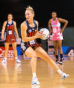 Hayley Saunders of the Tactix gathers the ball during the ANZ Championship Netball game between the Mainland Tactix v Adelaide Thunderbirds at Horncastle Arena in Christchurch. 20th April 2015 Photo: Joseph Johnson/www.photosport.co.nz