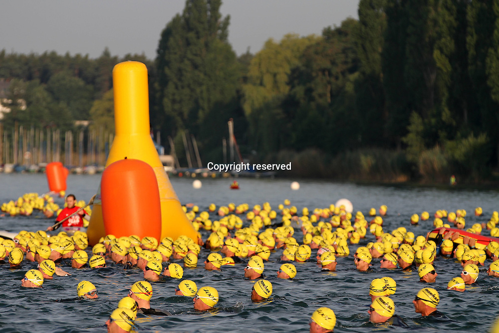 06.07.2014, Frankfurt, Germany. Ironman European Championships.   The Athletes with the Yellow caps launch at the Start