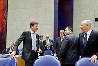 Nederland. Den Haag, 26 oktober 2010.<br /> De Tweede Kamer debatteert over de regeringsverklaring van het kabinet Rutte.<br /> Rutte temidden van zijn ministers : Hillen, Donner, Leers, Opstelten, de Jager, Rosenthal, mannen in kabinet, emancipatie, vrouwelijke ministers<br /> Kabinet Rutte, regeringsverklaring, tweede kamer, politiek, democratie. regeerakkoord, gedoogsteun, minderheidskabinet, eerste kabinet Rutte, Rutte1, Rutte I, debat, parlement<br /> Foto Martijn Beekman