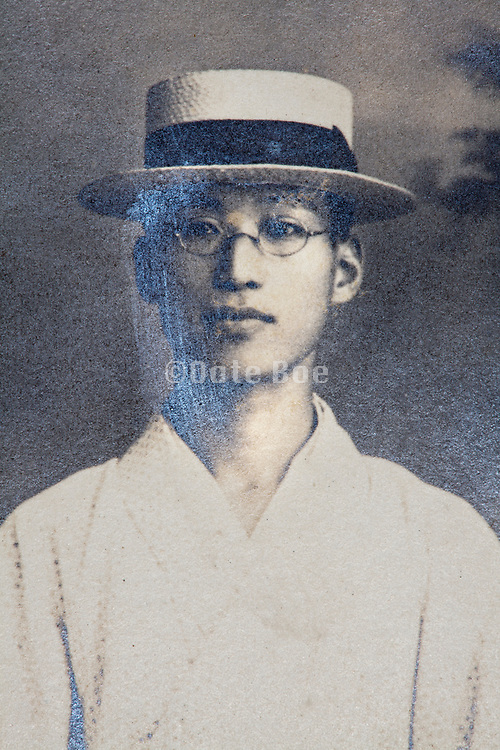 partly silver mirroring photograph with portrait of a young adult man Japan