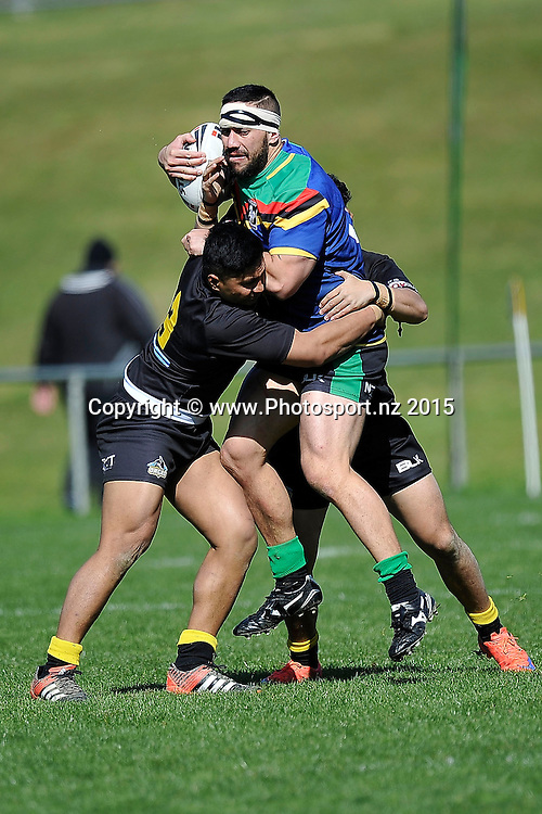 Eureka Keepa (C of the Stallions is tackled by Davis Saumolia (L) and Ulai Oti of the Orcas during the NRL National Premiership rugby league match between Wellington Orcas v Wai-Coa-Bay Stallions at Porirua Park in Wellington on Saturday the 12th September 2015. Copyright photo by Marty Melville / www.photosport.nz