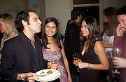 Zubin Varla, Meneka Das (mauve dress) Sheenu Das ( black dress) at Party after the opening of Salman Rushdie's 'Midnight's Children'  Bombay Brasserie. 28 January 2003. © Copyright Photograph by Dafydd Jones 66 Stockwell Park Rd. London SW9 0DA Tel 020 7733 0108 www.dafjones.com