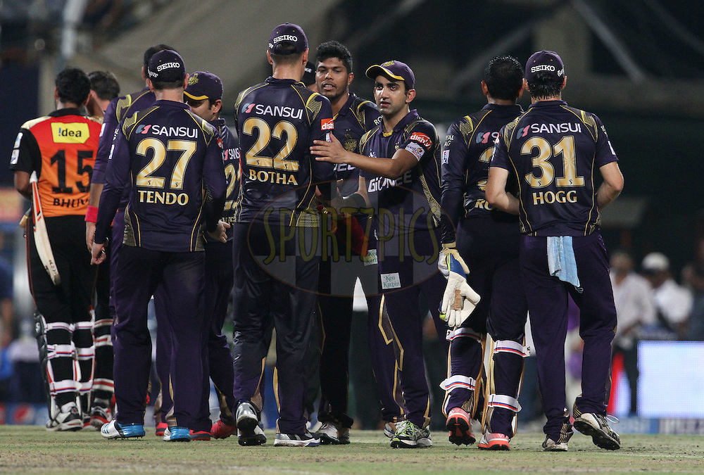 Kolkata Knight Riders players shake hands after winning the match 38 of the Pepsi IPL 2015 (Indian Premier League) between The Kolkata Knight Riders and The Sunrisers Hyderabad held at Eden Gardens Stadium in Kolkata, India on the 4th May 2015.<br /> <br /> Photo by:  Vipin Pawar / SPORTZPICS / IPL