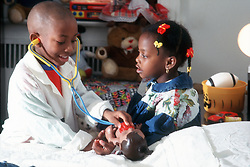 Small children playing doctors
