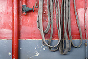a firehose waits ready for an emergency at a fire station aboard a Washington State Ferry on Puget Sound