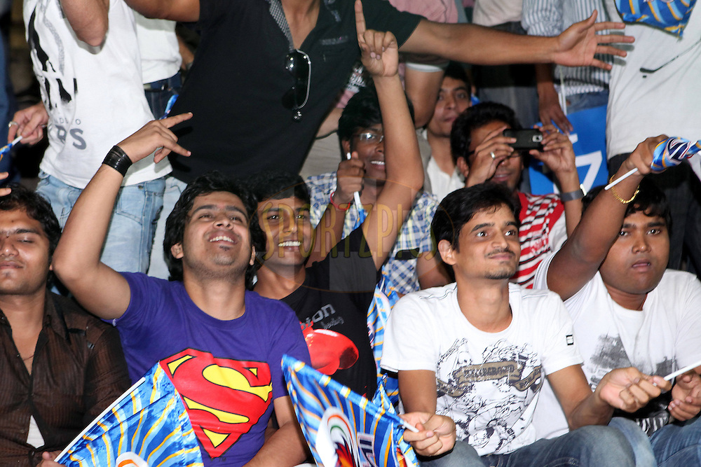 Fans enjoy the CLT20 atmosphere during match 11 of the NOKIA Champions League T20 ( CLT20 ) between the Mumbai Indians and The Cape Cobras held at the  M.Chinnaswamy Stadium in Bangalore , Karnataka, India on the 30th September 2011..Photo by Ron Gaunt/BCCI/SPORTZPICS
