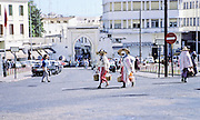 AFRICA; MOROCCO; TANGIER:  Main square of Tangier with gateway to the Kasbah, multitude of television antennas and people in traditional dress.