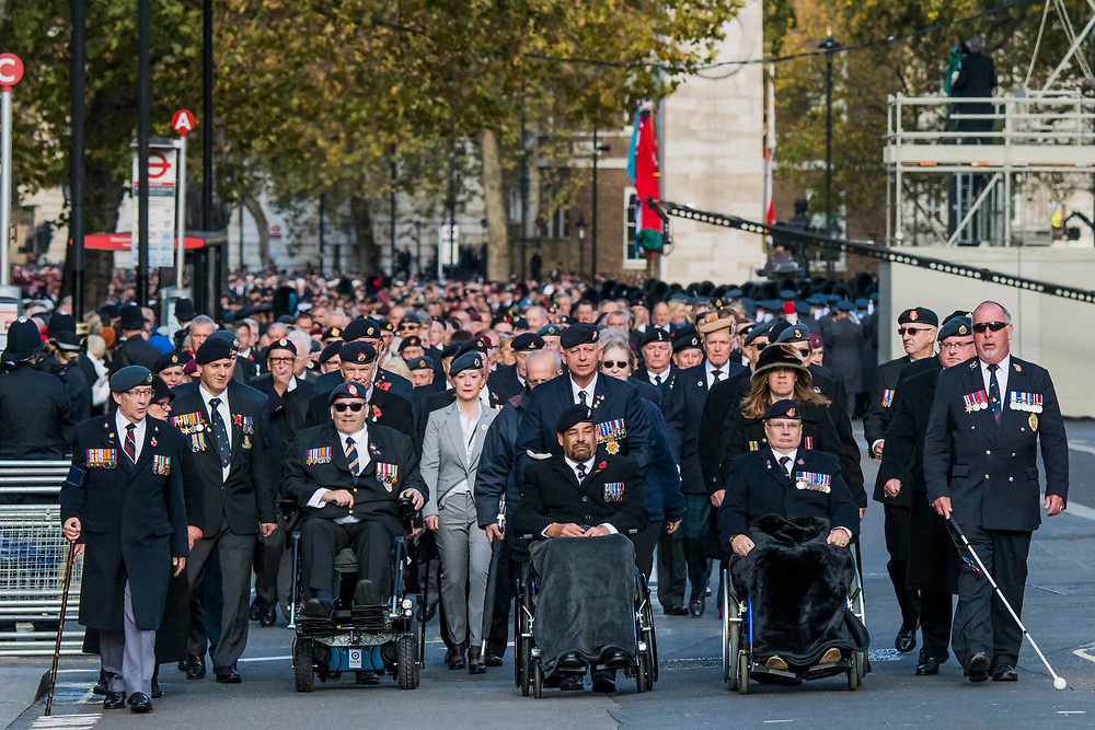 Veterans march past the Cenothaph and down Whitehall - Remembrance Sunday and Armistice Day commemorations fall on the same day, remembering the fallen of all conflicts but particularly the centenary of the end of World War One.