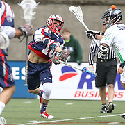 Stephen Berger #10 of the Boston Cannons follows through on his shot during the game at Harvard Stadium on April 27, 2014 in Boston, Massachusetts. (Photo by Elan Kawesch)