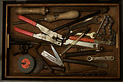 My Dad's tool chest. 2017. When my Dad died I inherited his tool chest which was filled with wonderful devices and fond memories. The smell of old tobacco tins containing taps and dies, oily rags and wood shavings, metal filings and tallow, brass backed saws and wheel braces, measuring devices and things to make other things… all beautifully preserved, greased and in perfect working order.My Dad, Leonard Walter Harris, was an electrician, boiler engineer and a quite brilliant carpenter. He joined the Royal Navy during WWII as a 17 year old junior 'Wireman' in 1943, lying about his age to escape the extreme poverty of Hackney in the east end of London.Dad served aboard various ships during campaigns in North Africa, Italy, Normandy and the Far East. He sailed to America to help bring a landing craft, LST 301 (Landing Ship Tank) across the Atlantic in preparation for the invasion of Europe in June 1944. Throughout his time in the navy he always took his tool chest, embellished with a name plaque, 'This is the property of Leonard W. Harris RN', with him on his travels.These photographs are part homage to my dad and part my way of preserving the memory of another era.