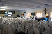 KOLKATA, INDIA 4 SEPT: Images from the Canonization of Saint Mother Teresa at the Motherhouse in Calcutta, India.<br /> PICTURED: The Missionaries of Charity watching the Canonization broadcast live from Rome.