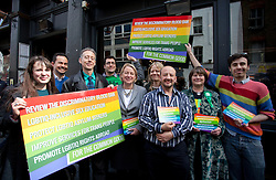 © Licensed to London News Pictures. 01/05/2015. London, UK. Natalie Bennett, centre, is joined by deputy leader Amelia Womack, left, and campaigner Peter Tatchell and supporters at Soho, central London, to launch Green Party's LGBTIQ manifesto. Ms Bennett announced Green pledges to review the discriminatory blood ban and introduce LGBTIQ-inclusive sex education. Photo credit: LNP