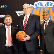 New York Knicks owner James Dolan (left) and Steve Mills, (right), General Manager at the Phil Jackson, (centre), press Conference introducing Jackson as the new president of the New York Knicks at Madison Square Garden, New York, USA. 18th March 2014. Photo Tim Clayton