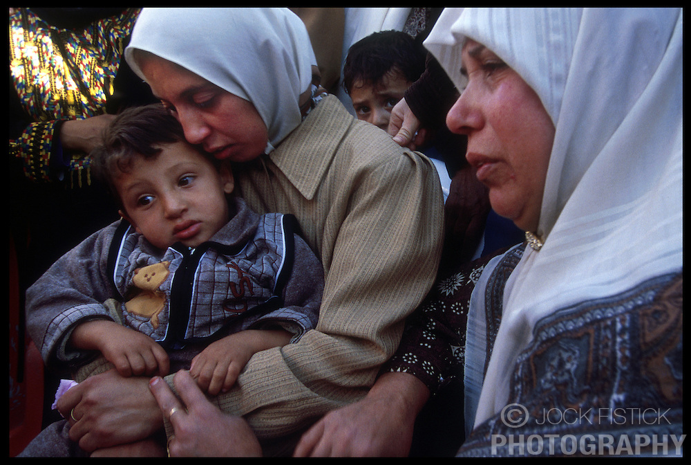The wife, son and relatives of Hani Marzouk, 38, mourn his death during a funeral in the West-bank city of Jenin. Marzouk, was wounded during clashes with Israeli soldiers in Nablus and died the following day. He was brought to his hometown of Jenin for his funeral approximately 100 kilometers North of Jerusalem. (Photo © Jock Fistick)