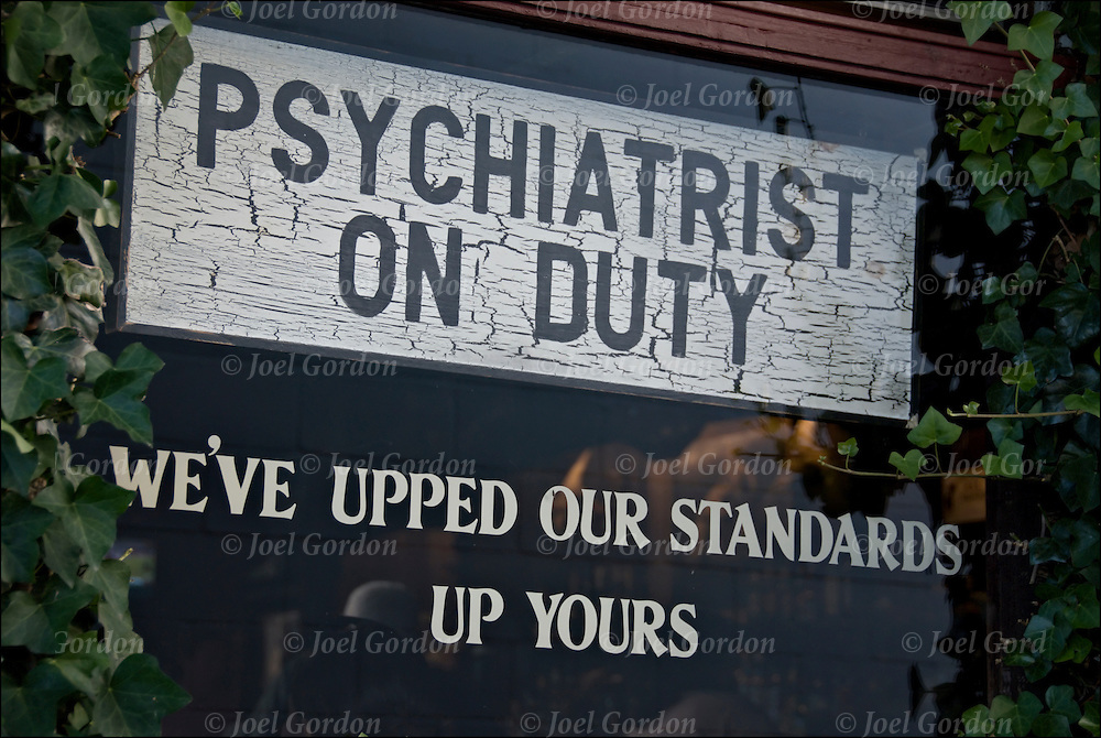 Psychiatrist On Duty, Humorous Signs on the walls of The Dock Restaurant Bar in Montauk Long Island. Reflect the sense of humor and attitude of the bar's owner, George.