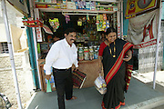 Jayant and Sangeeta Patkar stop at a kiosk to pick up some grocery items for their family food portrait. (Supporting image from the project Hungry Planet: What the World Eats.) The Patkar family of Ujjain, Madhya Pradesh, India, is one of the thirty families featured, with a weeks' worth of food, in the book Hungry Planet: What the World Eats.