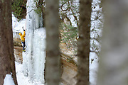 """UPPER PENNINSULA, MICHIGAN - FEBRUARY 2017: Climber Thaddeus VanDenBerg from Salt Lake City, Utah ice climbs """"Twin Falls"""" February 14, 2017 in Pictured Rocks National Lakeshore near Munising, Michigan. Waterfalls in the park freeze as pillars and curtains in winter and are quite popular with ice climbers. Every February the """"Michigan Ice Fest"""" ice climbing festival brings climbers from around the country and world to Munising. Photographer Bryan Mitchell spent a week in February wandering around to some of his favorite places in the UP to make some winter photos. (Photo by Bryan Mitchell/Special to Detroit News)"""