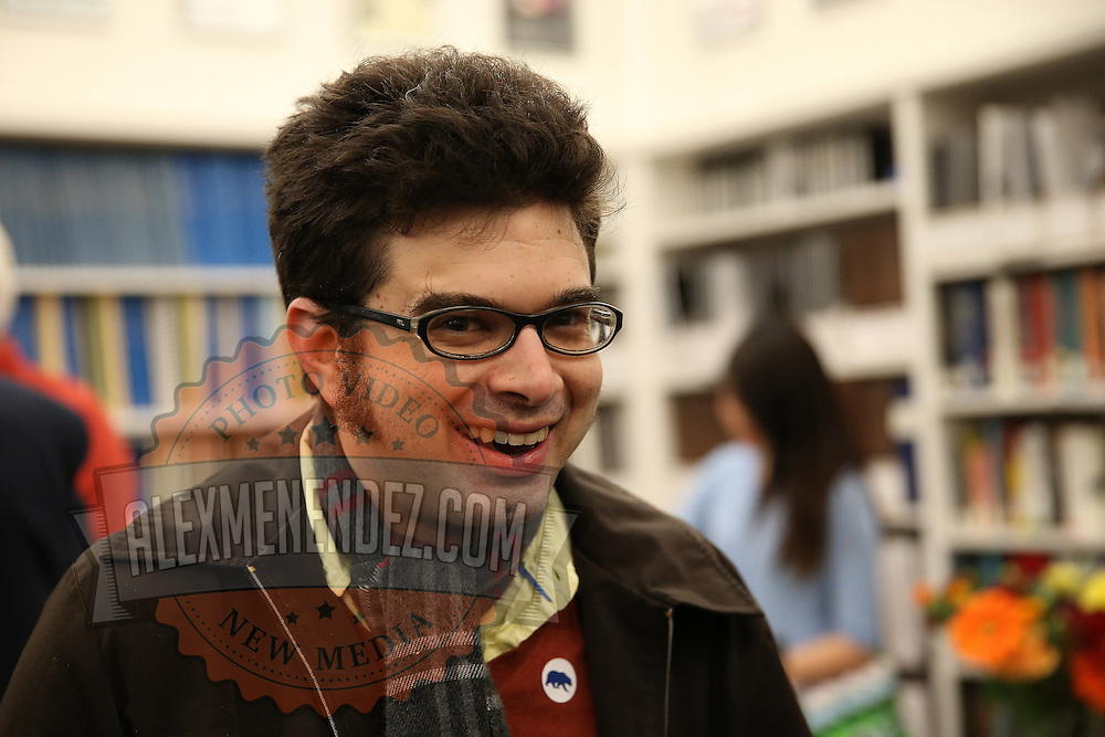 """Josh Wolf is seen prior to the """"Prosecuting the Press"""" event at the UC Berkeley Graduate School of Journalism in Berkeley, California, on Thursday, November 14, 2013. (AP Photo/Alex Menendez)"""
