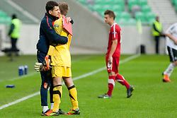 Marcin Dorna ,head coach of Poland, hugs goalie Oliver Schnitzler of Germany during the UEFA European Under-17 Championship Group A semifinal match between Germany and Poland on May 13, 2012 in SRC Stozice, Ljubljana, Slovenia. Germany defeated Poland 1:0. (Photo by Matic Klansek Velej / Sportida.com)