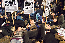 Westminster, London, December 2nd 2015.  As Parliament prepares to vote on air strikes on Islamic State terrorists in Syria, Stop The War and other groups opposed to British military involvement protest outside Parliament. PICTURED: Protesters hold a die-in on the streets outside Parliament. ///FOR LICENCING CONTACT: paul@pauldaveycreative.co.uk TEL:+44 (0) 7966 016 296 or +44 (0) 20 8969 6875. ©2015 Paul R Davey. All rights reserved.