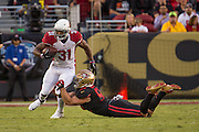 San Francisco 49ers linebacker Nick Bellore (50) tackles Arizona Cardinals running back David Johnson (31) at Levi's Stadium in Santa Clara, Calif., on October 6, 2016. (Stan Olszewski/Special to S.F. Examiner)