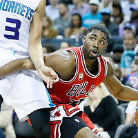 03 November 2015: Chicago Bulls guard E'Twaun Moore (55) drives past Charlotte Hornets guard Jeremy Lamb (3) during the Charlotte Hornets  130-105 victory over the Chicago Bulls, at the Time Warner Cable Arena, in Charlotte, North Carolina, USA.