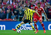 (L) Robert Lewandowski of Dortmund fights for the ball with (R) Jerome Boateng of Monachium during the UEFA Champions League Final football match between Borussia Dortmund and Bayern Munich at Wembley Stadium in London on May 25, 2013...England, London, May 25, 2013..Picture also available in RAW (NEF) or TIFF format on special request...For editorial use only. Any commercial or promotional use requires permission...Photo by © Adam Nurkiewicz / Mediasport
