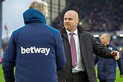 Burnley Manager Sean Dyche greets West Ham United Manager Manuel Pellegrini prior to kick off during the Premier League match between Burnley and West Ham United at Turf Moor, Burnley, England on 30 December 2018.