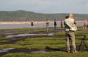 Photographing birds at the banks of Lake Nakuru, Kenya.