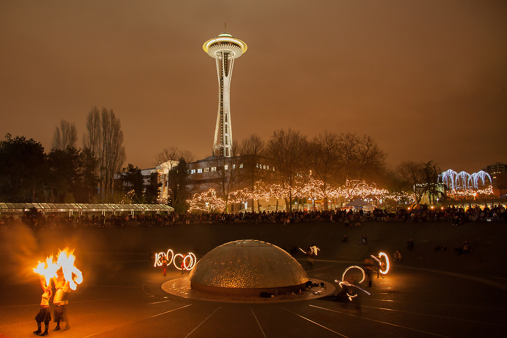 North America, United States, Washington, Seattle, fire dancers perform at Seattle Center during Winter Solstice Festival, in front of Space Needle