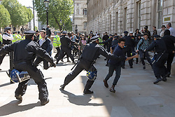 © Licensed to London News Pictures . 27/05/2013 . London , UK . Anti fascist protesters attempt to break through police lines towards the EDL demonstration , on Whitehall . The EDL march along Whitehall and hold a demonstration opposite Downing Street today (Monday 27th May 2013) . Photo credit : Joel Goodman/LNP
