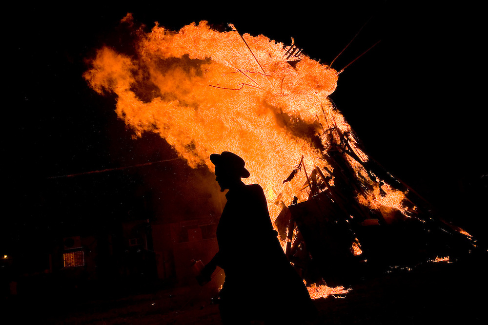 Israeli Ultra Orthodox light up a bonefire in the Ultra Othodox neighborhood of Mea Shearim on May 1, 2010 during celebrations for Lag Baomer, a Jewish festival which marks Bar Yochai's death. Yochai was a great scholar and one of the most important sages in Jewish history some 1,800 years ago. Thousands of Jews light large bonfires all night long all around Israel. Photo by Olivier Fitoussi /News Pictures