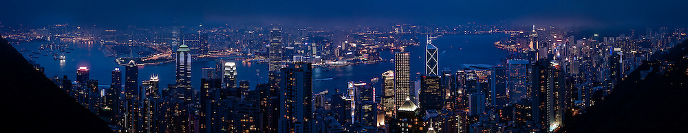 Looking at the Financial District and Victoria Harbor from Victoria Peak in Hong Kong at night