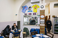 """POMIGLIANO D'ARCO, ITALY - 6 MARCH 2018: The clients and chefs of """"Addo Figlio è Peppe"""" restaurant, who claim to personally know the leader of the Five Star Movement Luigi Di Maio, are seen here shortly before the start of the celebration for the victory of Luigi Di Maio in the 2018 General Elections, in his hometown in Pomigliano D'Arco, Italy, on March 6th 2018.<br /> <br /> The Five-Star Movement, became the first party in Italy, with 33 percent of the vote."""