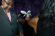 Debroah Burgens, center, prepares to get her photo taken with friends at the event photobooth during the Ohio University Black Alumni Reunion Gala held at the Baker Center Ballroom on Friday, September 16, 2016.