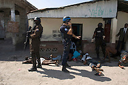A UN-led arrest operation in the Cité-de-Dieu neighbourhood, deemed illegal by human rights organizations. Port-au-Prince, February 1, 2008.