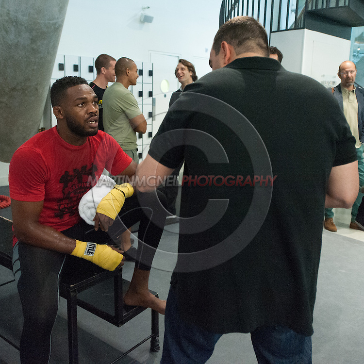 LONDON, ENGLAND, AUGUST 2, 2013: UFC light-heavyweight champion Jon Jones (left) talks wiht manager Malki Kawa inside Stars Gym in Battersea, London on Friday, August 2, 2013 © Martin McNeil