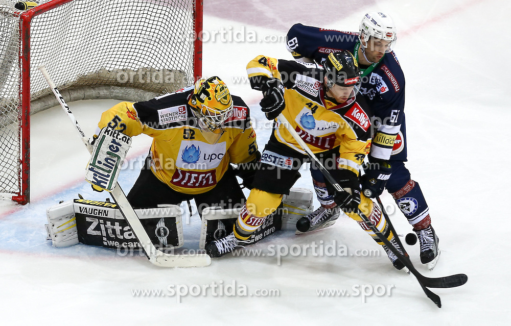28.12.2015, Albert Schultz Halle, Wien, AUT, EBEL, UPC Vienna Capitals vs EC VSV, 36. Runde, im Bild Nathan Lawson (Vienna Capitals) , Jamie Fraser (Vienna Capitals) und Rick Schofield (EC VSV) // during the Erste Bank Icehockey League 36th round match between UPC Vienna Capitals and EC VSV at the Albert Schultz Halle in Vienna, Austria on 2015/12/28. EXPA Pictures © 2015, PhotoCredit: EXPA/ Alexander Forst