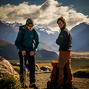 Hiking guides take a break while waiting for their group along the Sendero al Fitz Roy trail outside of the village of El Chalten, Argetina.