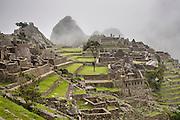 Inca Ruins at Machu Picchu, Peru on a misty, foggy day.