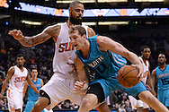 Jan 6, 2016; Phoenix, AZ, USA; Charlotte Hornets center Cody Zeller (40) handles the basketball against Phoenix Suns center Tyson Chandler (4) in the second half of the game at Talking Stick Resort Arena. The Phoenix Suns defeated the Charlotte Hornets 111-102. Mandatory Credit: Jennifer Stewart-USA TODAY Sports