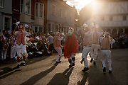 Thaxted Morris Weekend 3-4 June 2017<br /> A meeting of member clubs of the Morris Ring celebrating the 90th anniversary of the founding of the Thaxted Morris Dancing side or team in Thaxted, North West Essex, England UK. <br /> Thaxted side perfom in Town Street Thaxted Essex during the early evening mass dancing through the town.<br /> Hundred of Morris dancers from the UK and this year the Silkeborg side from Denmark spend most of Saturday dance outside pubs in nearby villages where much beer is consumed. In the late afternoon all the sides congregate in Thaxted where massed dancing is perfomed along Town Street. As darkness falls across Thaxted the spell binding Abbots Bromley Horn Dance is performed to the sound of a solo violin in the dark.