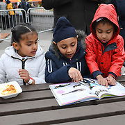 London, England, UK. 27 April 2019. Sikh children reading book at the  Vaisakhi Festival is a Sikh New Year in Trafalgar Square, London, UK.