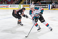 KELOWNA, CANADA - FEBRUARY 1: Jakob Stukel #10 of the Calgary Hitmen stick checks Cal Foote #25 of the Kelowna Rockets as he skates with the puck during second period on February 1, 2017 at Prospera Place in Kelowna, British Columbia, Canada.  (Photo by Marissa Baecker/Shoot the Breeze)  *** Local Caption ***